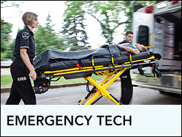Programs EMT showing two techs putting a person in a ambulance