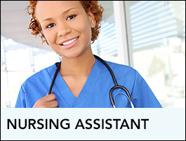 A nursing assistant looking at the camera and smiling